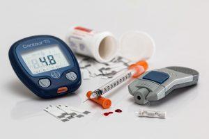 Blood sugar meter and supplies for managing diabetes.