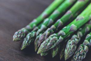 Healthy asparagus resting on table